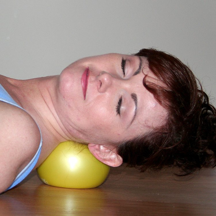 Client performing Self Myofascial Release on her neck