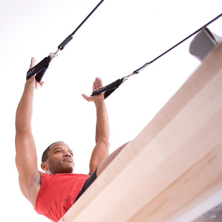 man exercising with cables