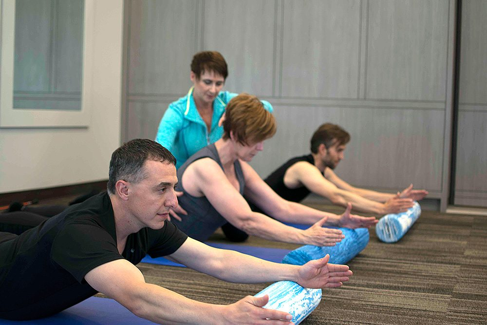 people performing pilates